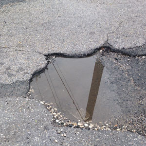 THE PERSISTENT PROBLEM OF POTHOLES