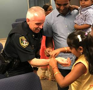 Dunwoody Police Department are invited to celebrate Raksha Bandhan