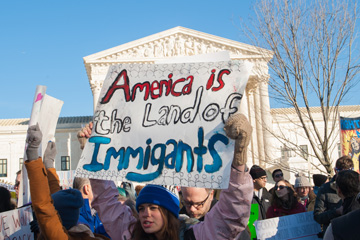 04_17_CvrStoryWarOnImmg-Land-of-Immigrants.jpg